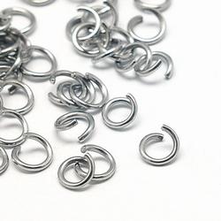 RVS dikke open 7mm ringetjes 10 gram +/- 95 stuks