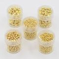 5 bakjes met goudkleurige balletjes 2 tot 5 mm